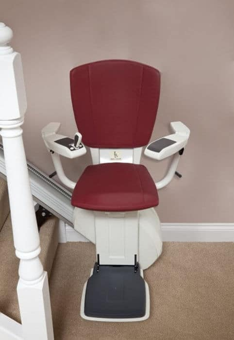 HomeGlide Extra ThyssenKrupp Straight Stairlift from 1st Choice Stairlifts in red upholstery