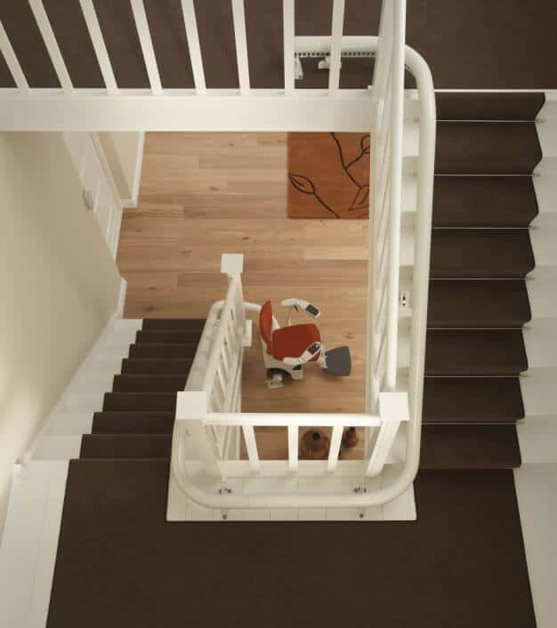 Flow Curved Stairlift from 1st Choice Stairlifts parked at bottom