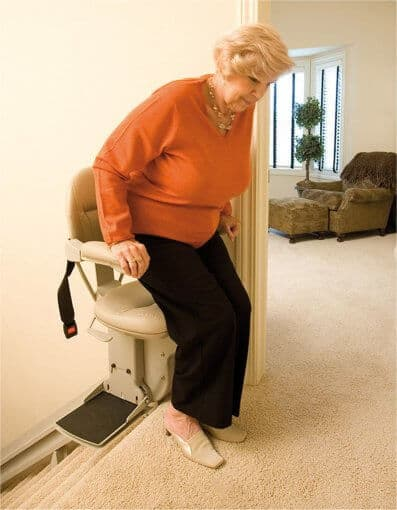 lady getting out of a stairlift