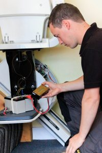 Stairlift Engineer Servicing a Stairlift