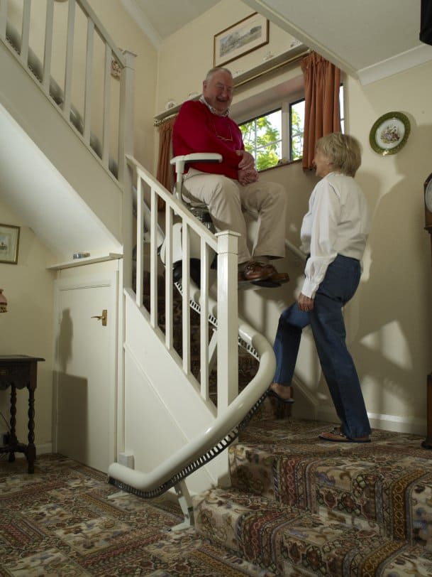 Stairlift with husband and wife carer
